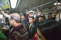 Delhi;India;Asia;construction;building;economy;boom;booming;transport;green-transport;railway;train;Metro;investment;investing;growth;Tiger-economy;infrastructure;fly-over;concrete;station;crowd;crowded;man;woman;carriage;railway-carriage;rush-hour;commuter;commuting;crush;pesonal-space;overcrowded;handle;hold;stand;standing