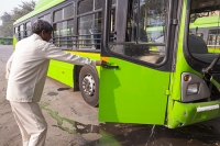 Delhi;India;Asia;transport;green-transport;infrastructure;CNG;compressed-natural-gas;bus;public-transport;Delhi-transport-Corporation;eco;green;environment;worlds-largest;fleet;emissions;clean;air-quality;exhaust;washing-out;cleaning