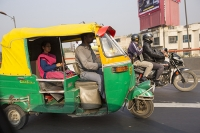 Delhi;India;Asia;transport;green-transport;road;tuctuc;taxi;CNG;compressed-natural-gas;green;yellow;pink;colourful;man;male;taxi-driver;passenger;woman;female;sari;saree
