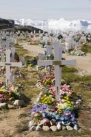 Ilulissat;Greenland;arctic;Inuit;grave;grave-yard;cemetary;buried;burial;dead;death;cross;gravestone;flowers;plastic-flowers;colour;colourful;ancestor;remembrance;worship;faith;christianity;faith;religion;relative;ice;iceberg;floating;sea;coast;Kangia;Ilulissat-glacier;Sermeq-Kujalleq