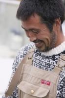 climate-change;global-warming;Greenland;Arctic;Illulissat;Unesco-world-heritage-site;landscape;summer;Illulissat-ice-fjord;sermeq-kujalleq;summer;Inuit;Jacobshaven;Jacobshaven-glacier;isbrae;fjord;fish;fisherman;man;male;Inuit;Eskimo;fishing;fisherman;face;jumper;wool;clothes;happy;smile;smiling;content;beard