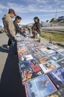 Ilulissat;Greenland;culture;eskimo;inuit;people;selling;stall;shop;town;village;entertainment;video;vidoe-tape;film;title;child;children