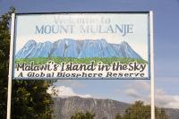 Africa;Malawi;rrural;countryside;peak;hill;kopje;sky;blue;cloud;woodland;granite;rock;geology;tree;green;rainy-season;Mulanje;mountain;sign;biosphere;biodiversity