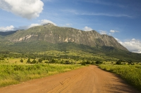Africa;Malawi;rrural;countryside;peak;hill;kopje;sky;blue;cloud;woodland;granite;rock;geology;tree;green;rainy-season;Mulanje;mountain;road;dirt-track;off-road;soil;track