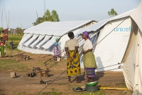 Malawi;Africa;Chiteskesa;refugee-camp;flood;floods;flooding;displaced;charity;NGO;aid;female;woman;black;African;green;dress;women;tent;shelter;disaster;disaster-relief;climate-change;global-warming;refugee;poor;poverty;Unicef;cooking-stove