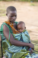 Malawi;Africa;Chiteskesa;refugee-camp;flood;floods;flooding;displaced;charity;NGO;aid;female;woman;black;African;green;dress;women;disaster;disaster-relief;climate-change;global-warming;refugee;poor;poverty;mother;child;baby;breast;breast-feeding;milk;mothers-milk