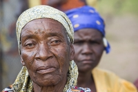 Malawi;Africa;Chiteskesa;refugee-camp;flood;floods;flooding;displaced;charity;NGO;aid;female;woman;black;African;green;dress;women;disaster;disaster-relief;climate-change;global-warming;refugee;poor;poverty;old;old-woman;sad;unhappy;lined;face;scarf;head-scarf