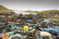 beach;pebble;Scotland;UK;coast;seaweed;plastic;bag;waste;rubbish;trash;garbage;pollution;toxic;Assynt;Rubha-Coigeach;Atlantic;colourful;debris;tide-wrack;washed-up;shore;washed-ashore;ocean-current;fishing-net;fishing-debris;glove;gloves;orange