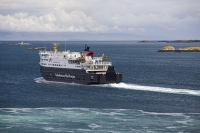 Isle-of-Harris;Outer-Hebrides;Scotland;UK;North-Harris;Tarbert;harbour;link;ferry;vehicle-ferry;port;Caledonian-Macbrayne;travel;transport;service;bow;ship;boat;wake;sea;sea-loch;leaving;coast;rocky;rugged