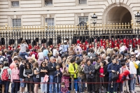 London;UK;capital;city;tourism;tourist-attraction;palace;Buckingham-Palace;Queen;residence;railings;fence;gold;gold-leaf;metal-work;steel;protection;England;English;monarch;head-of-state;tourist;tourism;tourist-attraction;man;woman;group;teenagers;teenager;male;female;friends;high-vis-jacket;high-visibility;Asian;chinese;students;children;crowds;spectacle;Busby;bear-skin-hat;palace-guard;red