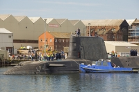 Barrow-in-Furness;Cumbria;UK;nuclear-submarine;Artful;Astute;hunter-killer;nuclear-powered-submarine;Navy;warfare;nuclear-deterrent;BAE-Systems;manufacturing;tug;boat;move;moving;police;policing;police-boat;Tomahawk-Cruise-missile;Tomahawk;Cruise-missile;submariner;dock-worker;workman;armed-services;shipbuilding;construction;economy;tax-spend;expensive;armed;dagerous;hunter-killer;warfare