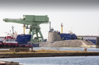 Barrow-in-Furness;Cumbria;UK;nuclear-submarine;Artful;Astute;hunter-killer;nuclear-powered-submarine;Navy;warfare;nuclear-deterrent;BAE-Systems;manufacturing;tug;boat;move;moving;police;policing;police-boat;Tomahawk-Cruise-missile;Tomahawk;Cruise-missile;submariner;dock-worker;workman;armed-services;shipbuilding;construction;economy;tax-spend;expensive;armed;dagerous;hunter-killer;warfare;nuclear-ship;nuclear-transport;MOX;MOX-fuel;plutonium-dioxide;radiation