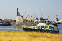 Barrow-in-Furness;Cumbria;UK;police;policing;nuclear-submarine;Artful;Astute;hunter-killer;nuclear-powered-submarine;Navy;warfare;nuclear-deterrent;BAE-Systems;manufacturing;tug;boat;move;moving;police-boat;shipbuilding;dockyard;navy;naval;submariner;dock-worker;shipbuilding
