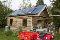 Scoraig;Little-Loch-Broom;Scotland;Highlands;remote;highlands;moorland;peninsular;community;green;off-grid;power;electricity;green;carbon-neutral;Coft;corfting;renewable-energy;wind-turbine;self-sufficiency;home-made;DIY;resilience;self-supporting;blade;basic;wire;support;pole;blade;croft;crofting;woodland;shelter;quad-bike;trailer;man;male;shed;solar-panel;PV;photo-voltaic