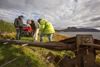 Scoraig;Little-Loch-Broom;Scotland;Highlands;remote;highlands;moorland;peninsular;community;green;off-grid;power;electricity;green;carbon-neutral;Coft;corfting;renewable-energy;wind-turbine;self-sufficiency;home-made;DIY;resilience;self-supporting;blade;basic;wire;support;pole;blade;croft;crofting;man;male;engineer;maintenance;tools;reapir;self-sufficient;hill;peak;mountain;shore;windy;exposed;carbon-footprint;climate-change;global-warming