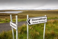 Lewis;Isle-of-Lewis;Outer-Hebrides;Hebrides;Scotland;UK;remote;peat;peat-bog;peat-cutting;fuel;energy;power;fossil-fuel;Stornoway;Pentland-road;road-sign;junction;Briescleat;language;Gaelic