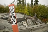 global-warming;climate-change;warming;climate;meteorology;man-made;impact;change;weather;extreme-weather;change;weather-patterns;science;Alaska;USA;Arctic;Fairbanks;permafrost;frost;forzen;freezing;cold;warming;melt;melting;unstable;soil;subsoil;damage;damaged;destruction;destroyed;economy;economic-cost;costly;expensive;implications;tundra;northern;Co2-emmissions;carbon-dioxide;greenhouse-gas;infrastructure;building;collapse;collapsing;survey;marker;measure;abandoned;housing;house