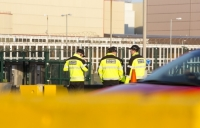 20130228_B18A2968.jpg Security guards at one of the entrances to Sellafield nuclear power station near Seascale in West Cumbria, UK, with concrete security barriers in the foreground.