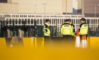 20130228_B18A2972.jpg Security guards at one of the entrances to Sellafield nuclear power station near Seascale in West Cumbria, UK, with concrete security barriers in the foreground.