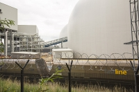 Drax;Drax-power-station;power;power-station;generating;electricity;climate-change;global-warming;emissions;greenhouse-gas;polluter;polluting;electricity;Yorkshire;UK;energy;grid;electric;cooling-tower;infrastructure;biofuel;bio-fuel;wood;greenwash;greenwashing;C02;carbon-dioxide;greenhouse-gas;coal-coal-fired-power-station;conversion;converting;dome;construction;building;building-work;architecture;store;store-house;store-room;biofuel-store;lift;red;tower;crane;train;railway;haulage;freight;freight-train