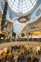 Christmas-shoppers;Trafford-Centre;Manchester;UK;Christmas-shopping;Christmas-xmas;xmas-shopping;seasonal;winter-shopping;shopping-mall-shops;shop;retail;festive;decorations-christmas-decorations;xmas-decorations;arcade;shopping-arcade;economy;crowd;crowds;crowded;busy;footfall;spending;atmosphere;atrium-levels;stairs;stairway