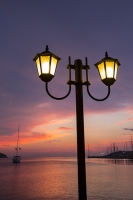 Sivota;Greece;Mediterranean;sea;coast;warm;tranquill;calm;serene;harbour;port;sunset;evening;glow;warm;light;waterfront;light;lamp;street-light;street-lamp;lamp-post;yacht;sailing-boat