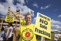fracking;frack;gas;shale-gas;energy;power;drilling;protest;banner;anti;camp;protest-camp;environment;environmentalist;green;politics;planning-permission;Lancashire;UK;Fylde;Blackpool;Little-Plumpton;farmland;colourful;protest;protesting;colourful;campaign;climate-change;global-warming;pollution;destruction;health;future;tent;woman;female;middle-aged;fifties;sixties;movement;banner;placard;Cuadrilla