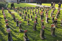 flood;flooding;floods;London;UK;Greenpeace;charity;NGO;protest;art;instalation;pop-up-art;protest;protesting;activist;envirnoment;art;wellies;wellington-boots;rubber-boots;message;communication;flood-victim;volunteer;Westminster;stunt;PR