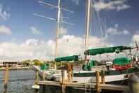 America;USA;Florida;Miami;coast;ocean;sea;Atlantic;Atlantic-Ocean;Miami-Beach;waterfront;vulnerable;sea-level-rise;mooring;wharf;moored;sailing-boat;boat;ketch;mast;heritage;stars-and-stripes;flag