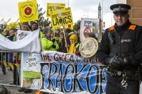 fracking;shale-gas;Blackpool;Lancashire;UK;protest;fossil-fuel;climate-change;global-warming;banner;placard;concern;environment;environmentalist;yellow;colourful;gas;energy;energy-policy;planning;planning-application;planning-appeal;Cuadrilla;David-and-Goliath;battle;localism;democracy;person;man;woman;concerned;green;Blackpool-Tower;police;police-man