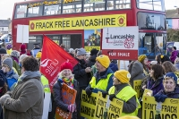 fracking;shale-gas;Blackpool;Lancashire;UK;protest;fossil-fuel;climate-change;global-warming;banner;placard;concern;environment;environmentalist;yellow;colourful;gas;energy;energy-policy;planning;planning-application;planning-appeal;Cuadrilla;David-and-Goliath;battle;localism;democracy;person;man;woman;concerned;green;red;bus;double-decker;double-decker-bus;battle-bus
