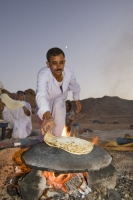 Egypt;Sinai;desert;sinai-desert;Dahab;Red-Sea;sand;sandy;rocky;outcrop;sky;night;sky;star;bedouin;arab;arabic;guide;light;camp;camping;nomad;nomadic;lifestyle;culture;arab;arabic;man;male;fire;cook;cooking;bread;prepare;meal;flame;food;meal;moon