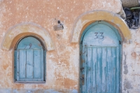 Egypt;Sinai;desert;sinai-desert;Dahab;Red-Sea;house;housing;accomodation;door;front-door;poor;impoverished;poverty;run-down;basic;facilities;arab;arabic;architecture;shack;hovel;number;colour;peach;blue;orange;window