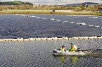Hyde;Manchester;UK;United-Utilities;reservoir;water;water-supply;drinking-water;solar;solar-power;solar-farm;floating;floating-solar;solar-panel;PV;photo-voltaic;electricity;green;clean;carbon-neutral;climate-change;global-warming;innovative;novel;floats;renewable-energy;man;male;workman;PPE;health-and-safety;high-vis;green-jobs;boat;inflateable;rib