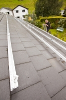 IMG_0515_p.jpg Fitting support rails to a house roof in Ambleside, Cumbria, UK, to support solar photo voltaic panels.
