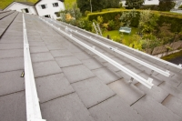 IMG_0517_p.jpg Fitting support rails to a house roof in Ambleside, Cumbria, UK, to support solar photo voltaic panels.