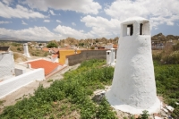 Guadix;Andalucia;Spain;town;rock;stone;geology;cave;house;cave-house;dwelling;cool;underground;Barrio-Santiago;old;ancient;querky;unusual;housing;house;white-washed;clay;hill;hummock;hummocky;topography;chimney