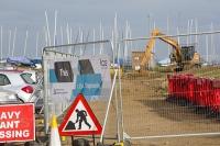 Blakeney;Norfolk;UK;North-Norfolk;coast;tidal;tidal-flooding;flood-surge;boat;damage;JCB;plant;digger;sea-wall;levee;protection;coastal-protection;coastal-defences;defences;repair;repairing;storm-damage;fence;sign