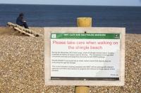 Cley;Norfolk;UK;North-Norfolk;coast;tidal;beach;shingle;flint;cobble;sign;warning;damage;flood-surge;storm-surge