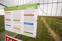 Blakeney;Norfolk;UK;North-Norfolk;coast;tidal;tidal-flooding;flood-surge;boat;damage;sea-wall;levee;protection;coastal-protection;coastal-defences;defences;repair;repairing;storm-damage;fence;sign;Environment-Agency