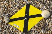 Cley;Norfolk;UK;North-Norfolk;coast;tidal;beach;shingle;flint;cobble;damage;flood-surge;storm-surge;breach;breached;storm-beach;yellow;black;cross;marker;aerial-survey;survey-marker;coastal-erosion