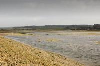Cley;Norfolk;UK;North-Norfolk;coast;tidal;beach;shingle;flint;cobble;damage;flood-surge;storm-surge;breach;breached;storm-beach;inundated;wildlife-reserve;bird-reserve;salthouse;field;flooding;flooded;wetland;habitat