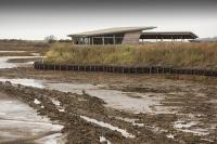 Norfolk;UK;North-Norfolk;coast;tidal;beach;shingle;flint;cobble;damage;flood-surge;storm-surge;person;walker;walking;breach;breached;storm-beach;inundated;wildlife-reserve;bird-reserve;Titchwell;RSPB