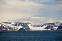 ice-cliff-Spitsbergen-Svalbard-Norway-hill-mountain-rock-ice-gla