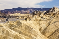 California;USA;America;Death-Valley;desert;drought;hot;dry;low;heat;National-Park;preserved;protected;dessicated;barren;mountain;mountain-range;geology;rocks;sand;sandy;badlands;gully;gulch;erosion;weathering;layer;layering;bedding;Zabriskie-Point;scenery;landscape