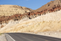 California;USA;America;Death-Valley;desert;drought;hot;dry;low;heat;National-Park;preserved;protected;dessicated;barren;mountain;mountain-range;geology;rocks;sand;sandy;badlands;gully;gulch;erosion;weathering;layer;layering;bedding;Zabriskie-Point;scenery;landscape;road;travel