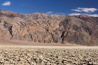 California;USA;America;Death-Valley;desert;drought;hot;dry;low;heat;National-Park;preserved;protected;dessicated;barren;mountain;mountain-range;geology;rocks;sand;sandy;badlands;scenery;landscape;blue;sky;Devils-Golf-Course;lumpy;tourist-attraction;heave;salt-pan;Mojave-Desert