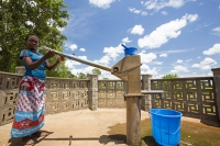 Malawi;Africa;Baani;female;black;African;poverty;sunlight;woman;sky;blue;cloud;colourful;pump;pumping;well;water;supply;water;ground-water