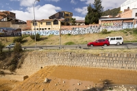 orange;brown;river;water;water-supply;polluted;pollution;contaminated;mine-waste;effluent;La-Paz;Bolivia;South-America;sediment-load;colour;discoloured;iron;water-shortage;waterfall;road;mural;art;graffiti;traffic;car
