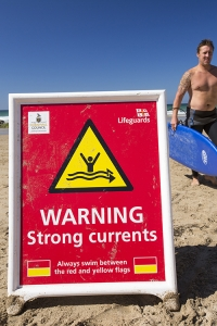 Cornwall;UK;coast;plant;St-Agnes;sea;cliff;sea-cliff;summer;sign;yellow;South-west;warm;cove;beach;Coast-guard;life-guard;vehicle;four-wheel-drive;surfing;surf-board;pebble;sand;Chapel-Porth;red;warning;currents;strong-currents;danger;man
